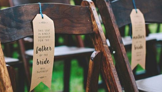http://somethingturquoise.com/2015/11/10/diy-wedding-ceremony-chair-reserved-signs/